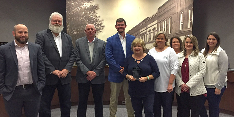 About Our Agency - Portrait of FIrst Security Insurance Team at Hickory NC Reward Ceremony